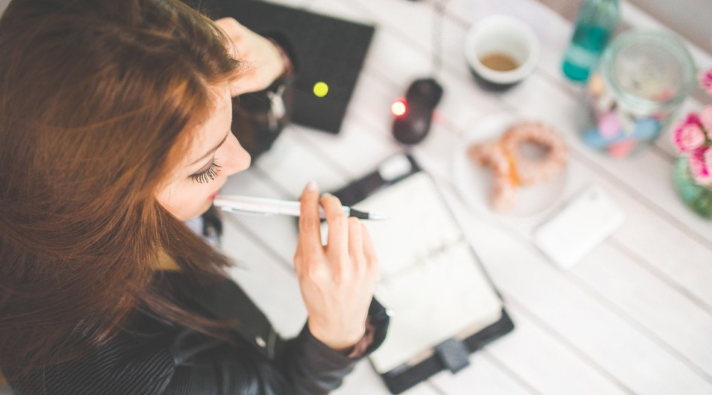Bring work Productivity  Home. Photo by: https://www.pexels.com/photo/young-woman-thinking-with-pen-while-working-studying-at-her-desk-6384/